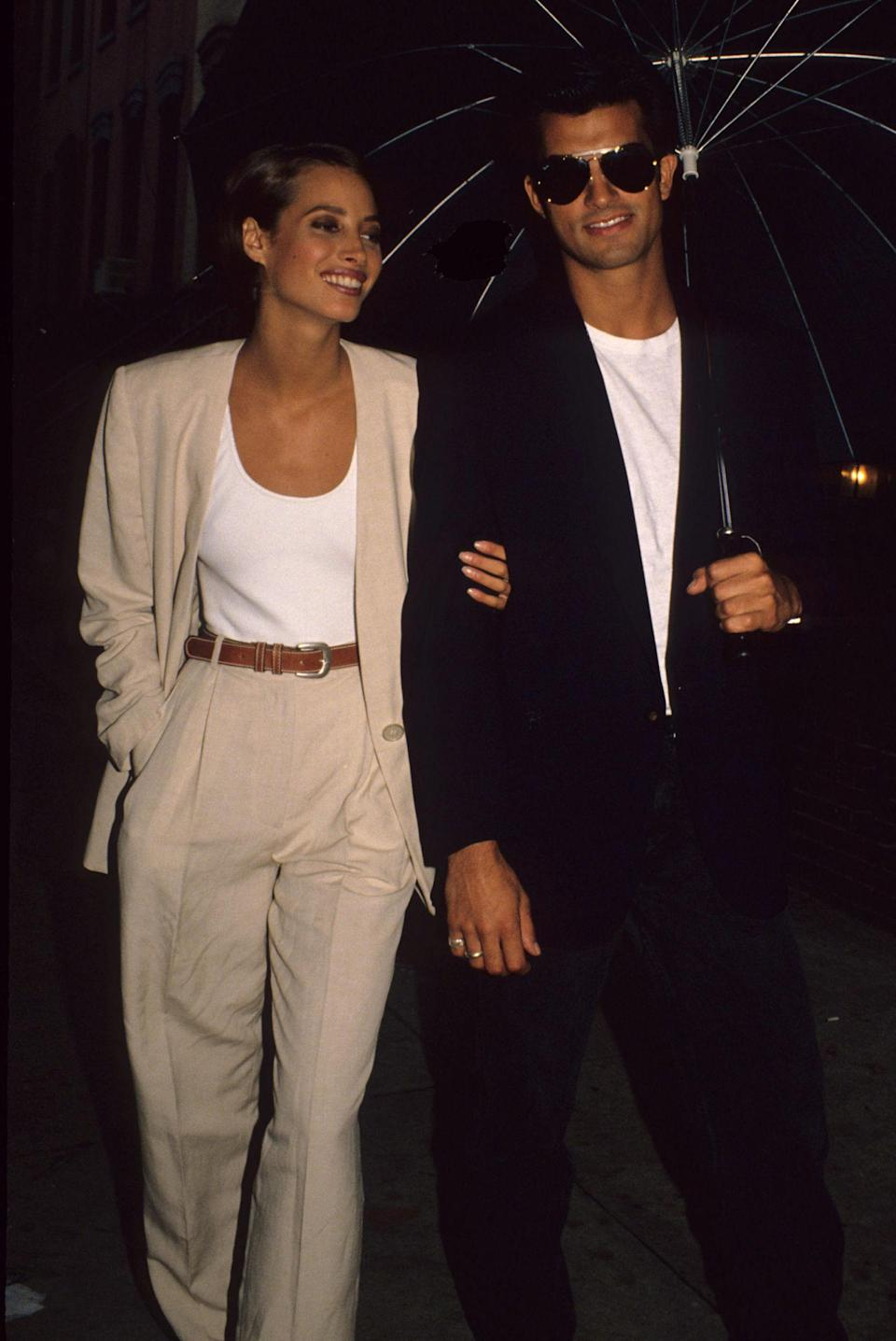 <p>Christy Turlington cinches in her waist with a brown belt to separate this co-ord suit</p>