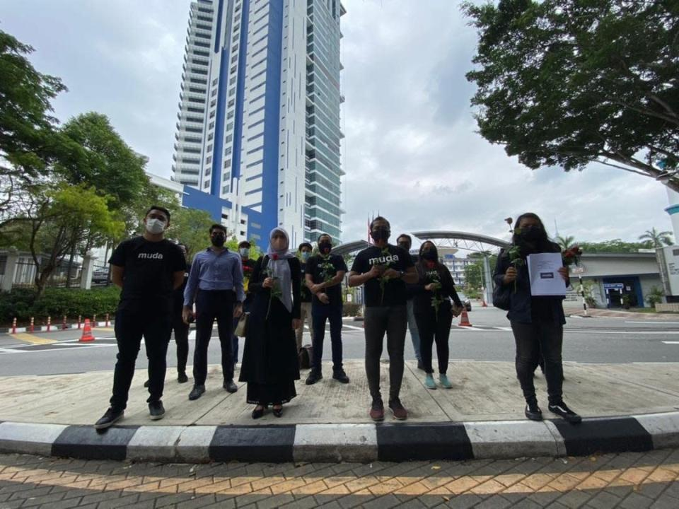 Members of the Malaysian United Democratic Alliance are pictured outside Bukit Aman, Kuala Lumpur March 23, 2021. — Picture via Twitter