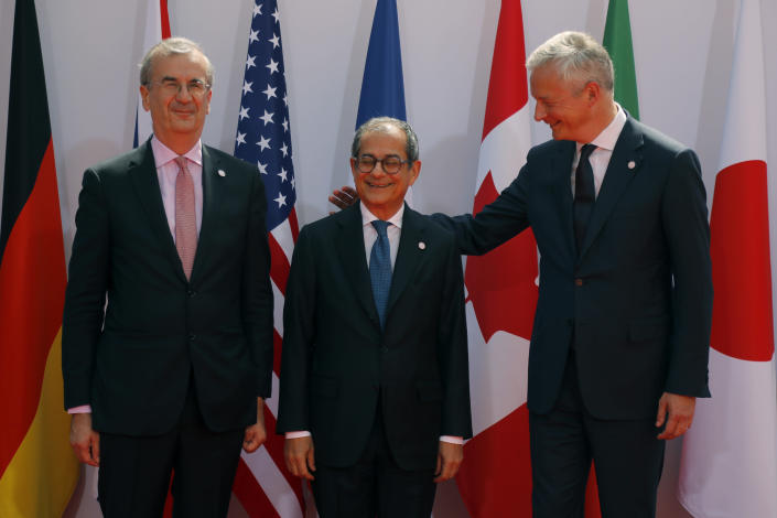 French Finance Minister Bruno Le Maire, right, welcomes Italian Economy and Finance Minister Giovanni Tria , center, with Governor of the Bank of France Francois Villeroy de Galhau, at the G-7 Finance Wednesday July 17, 2019.The top finance officials of the Group of Seven rich democracies are arriving at Chantilly, at the start of a two-day meeting aimed at finding common ground on how to tax technology companies and on the risk from new digital currencies. (AP Photo/Michel Euler)