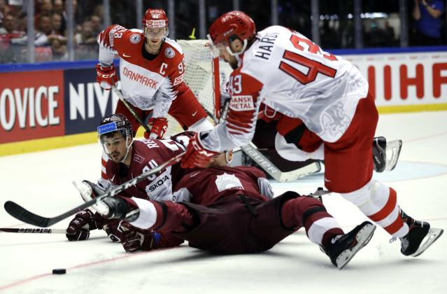 Ice Hockey - 2018 IIHF World Championships - Group B - Latvia v Denmark - Jyske Bank Boxen - Herning, Denmark - May 15, 2018 - Oskars Cibulskis and Mikelis Redlihs of Latvia in action with Nichlas Hardt and Peter Regin of Denmark. REUTERS/David W Cerny