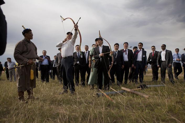 Biden and Mongolian Prime Minister Sukhbaatar Batbold try out archery in Ulaanbataar, Mongolia, on Aug. 22, 2011.