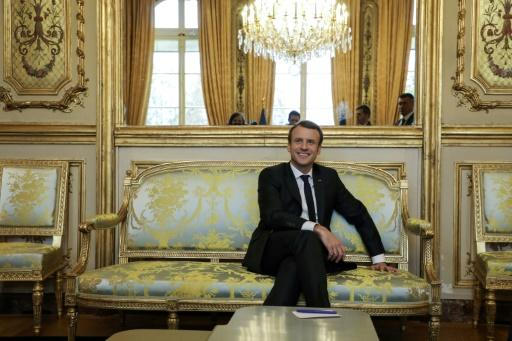French MPs back Macron's cost-cutting first budget