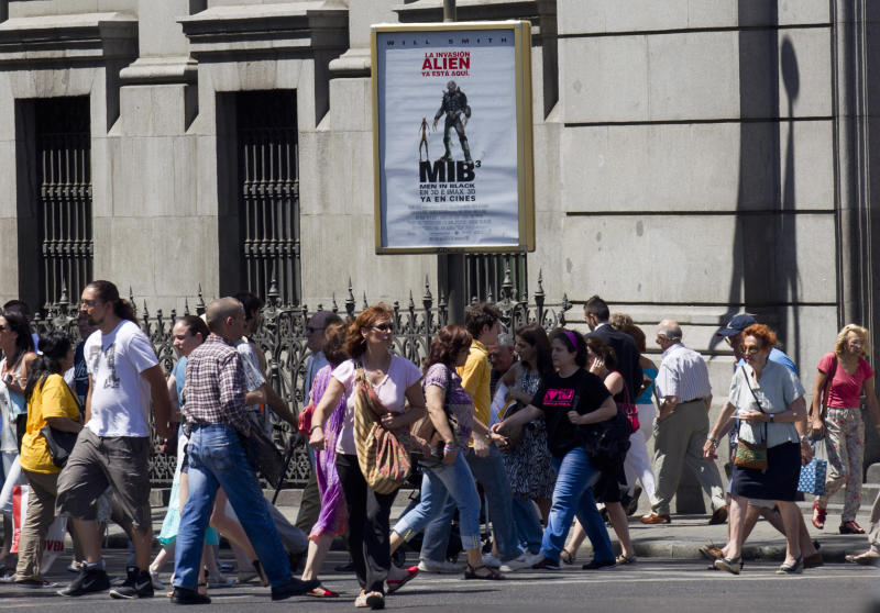 A movie poster for the film 'Men in Black' hangs outside the Bank of Spain in Madrid Tuesday June 5, 2012. Finance Minister Cristobal Montoro speaking on Onda Cero radio Tuesday said that the men in black would not be coming to Spain in reference to international inspectors. Montoro also said the amount of money needed to recapitalize Spain's troubled banking sector is not excessively high and calls on the European Union to move faster toward a banking union that would allow ailing entities to seek help without governments intervening.  (AP Photo/Paul White)