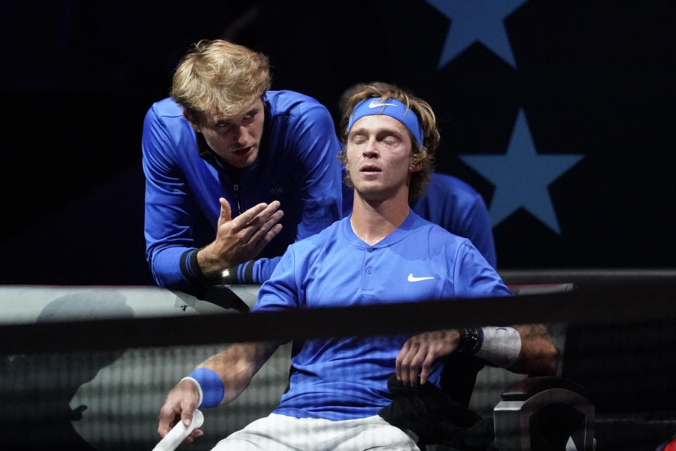 Team Europe's Alexander Zverev, of Germany, left, speaks to teammate Andrey Rublev, of Russia, during a break in his match against Team World's Diego Schwartzman, of Argentina, at Laver Cup tennis, Friday, Sept. 24, 2021, in Boston. (AP Photo/Elise Amendola)