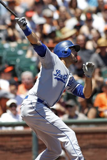 Los Angeles Dodgers' Andre Ethier hits an RBI single against the San Francisco Giants' during the second inning of a baseball game in San Francisco, Sunday, July 7, 2013. (AP Photo/George Nikitin)