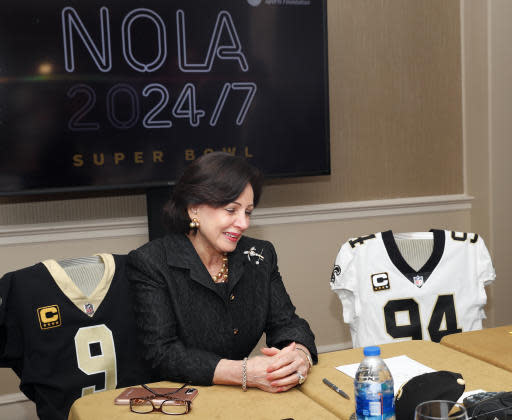 New Orleans Saints owner Gayle Benson uses a speaker phone to inform Governor of Louisiana John Bel Edwards other elected officials that New Orleans has been awarded the 2024 Super Bowl during the NFL owner's spring meeting Wednesday, May 23, 2018, in Atlanta. (AP Photo/John Bazemore)
