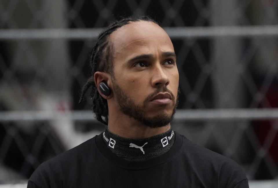 Mercedes driver Lewis Hamilton of Britain looks on before the Russian Formula One Grand Prix at the Sochi Autodrom circuit, in Sochi, Russia, Sunday, Sept. 26, 2021. (AP Photo/Sergei Grits)