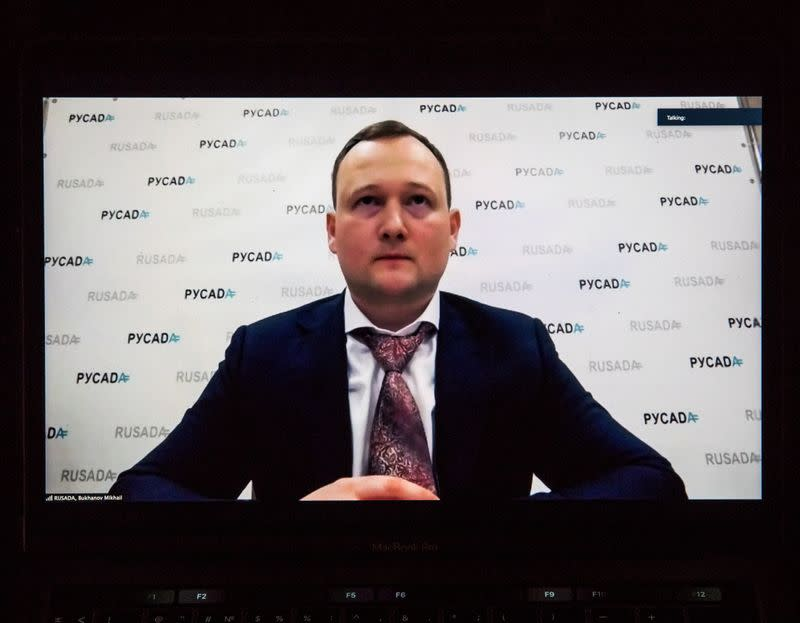 Mikhail Bukhanov, acting Director General of Russian Anti-Doping Agency (RUSADA), is seen on a screen during a news briefing in Moscow,