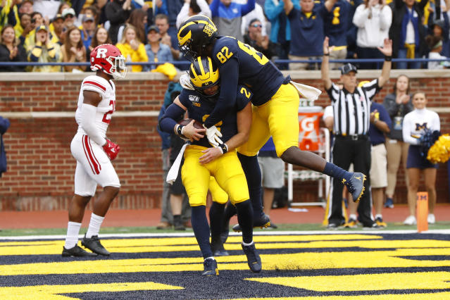 Michigan quarterback Shea Patterson (2) celebrates his four-yard touchdown run with Nick Eubanks (82) in the first half of an NCAA college football game against Rutgers in Ann Arbor, Mich., Saturday, Sept. 28, 2019. (AP Photo/Paul Sancya)