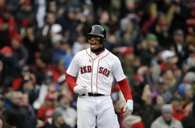 Mookie Betts and the Red Sox completely an unlikely comeback Sunday. (AP Photo)