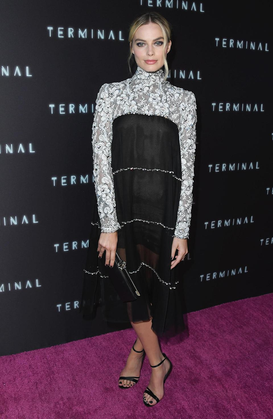 <p>Brand spanking new brand ambassador Margot Robbie made a good case for Chanel, wearing a dress from their autumn/winter 2018 collection. The sheer lace bottom with white floral appliqué sleeves looked gorgeously elegant on the actress.<br><em>[Photo: Getty]</em> </p>