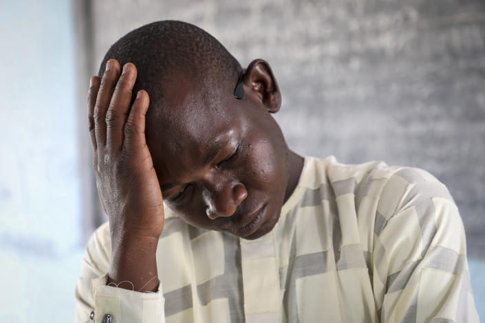 Zubairu Sanusi, a chemistry teacher and father of two kidnapped girls at the boarding school where more than 300 girls were abducted by gunmen on Friday, speaks to The Associated Press in the town of in Jangebe, in Zamfara state, northern Nigeria Saturday, Feb. 27, 2021. Nigerian police and the military have begun joint operations to rescue the more than 300 girls who were kidnapped from the Government Girls Junior Secondary School, according to a police spokesman. (AP Photo/Ibrahim Mansur)
