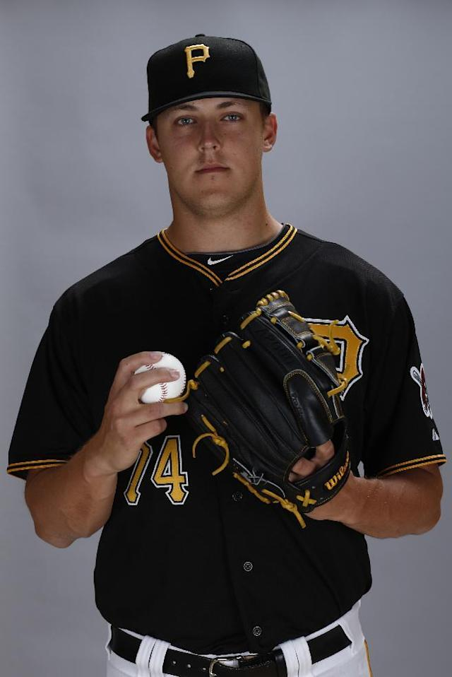 This is a 2014 photo of Jameson Taillon of the Pittsburgh Pirates baseball team. This image reflects the Pirates active roster as of Friday, Feb. 21, 2014 when this image was taken at spring training in Bradenton, Fla. (AP Photo/Gene J. Puskar)