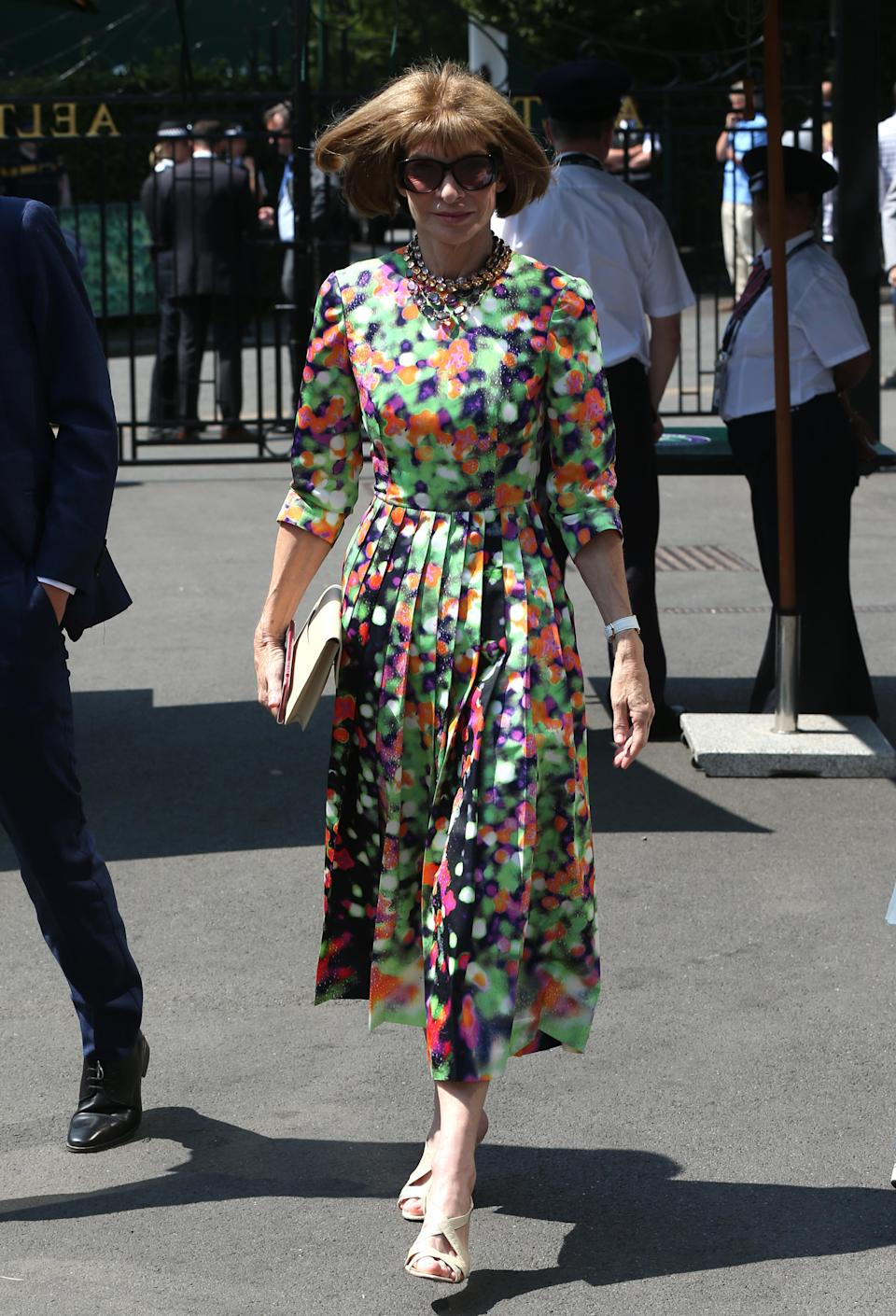 <p>Anna Wintour stole the sartorial spotlight on 13 July in a printed midi dress and her trademark sunnies.<em> [Photo: PA]</em> </p>
