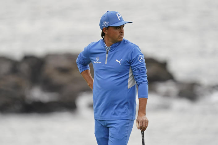 FILE - In this Feb. 11, 2021, file photo, Rickie Fowler looks out from the eighth green of the Pebble Beach Golf Links during the first round of the AT&T Pebble Beach Pro-Am golf tournament in Pebble Beach, Calif. For the first time, Fowler needed a special invitation to play in the PGA Championship next week. (AP Photo/Eric Risberg, File)