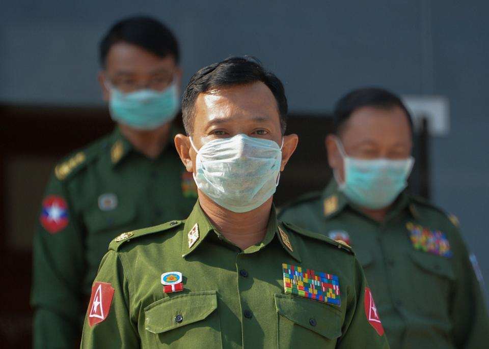 The military-appointed members of parliament wearing face masks amid fears about the spread of the COVID-19 novel coronavirus leave after a session in Naypyidaw on March 4, 2020. - Myanmars military dominates the country's politics, holding a quarter of seats in parliament and controlling three ministries. (Photo by Thet Aung / AFP) (Photo by THET AUNG/AFP via Getty Images)