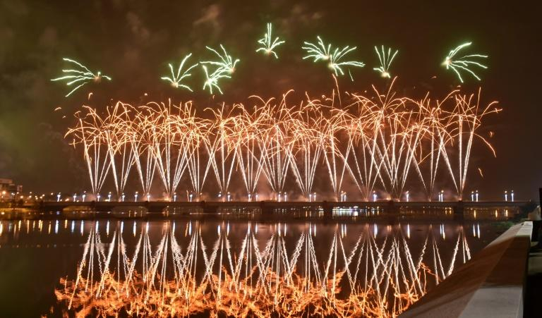 Fireworks light up the sky over the General de Gaulle bridge and the Ebrie lagoon during New Year's celebrations in Abidjan, Ivory Coast