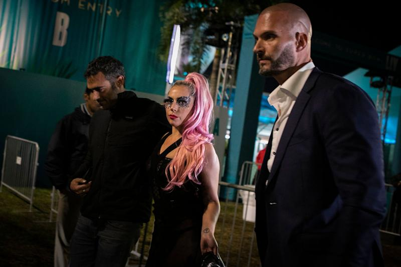 Lady Gaga and Michael Polanksy, left, leave the Super Bowl in Miami Gardens, Florida. (Photo: EVA MARIE UZCATEGUI via Getty Images)