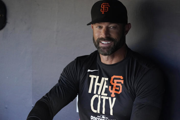 San Francisco Giants manager Gabe Kapler sits in the dugout before Game 4 of the baseball team's National League Division Series against the Los Angeles Dodgers, Tuesday, Oct. 12, 2021, in Los Angeles. (AP Photo/Marcio Jose Sanchez)