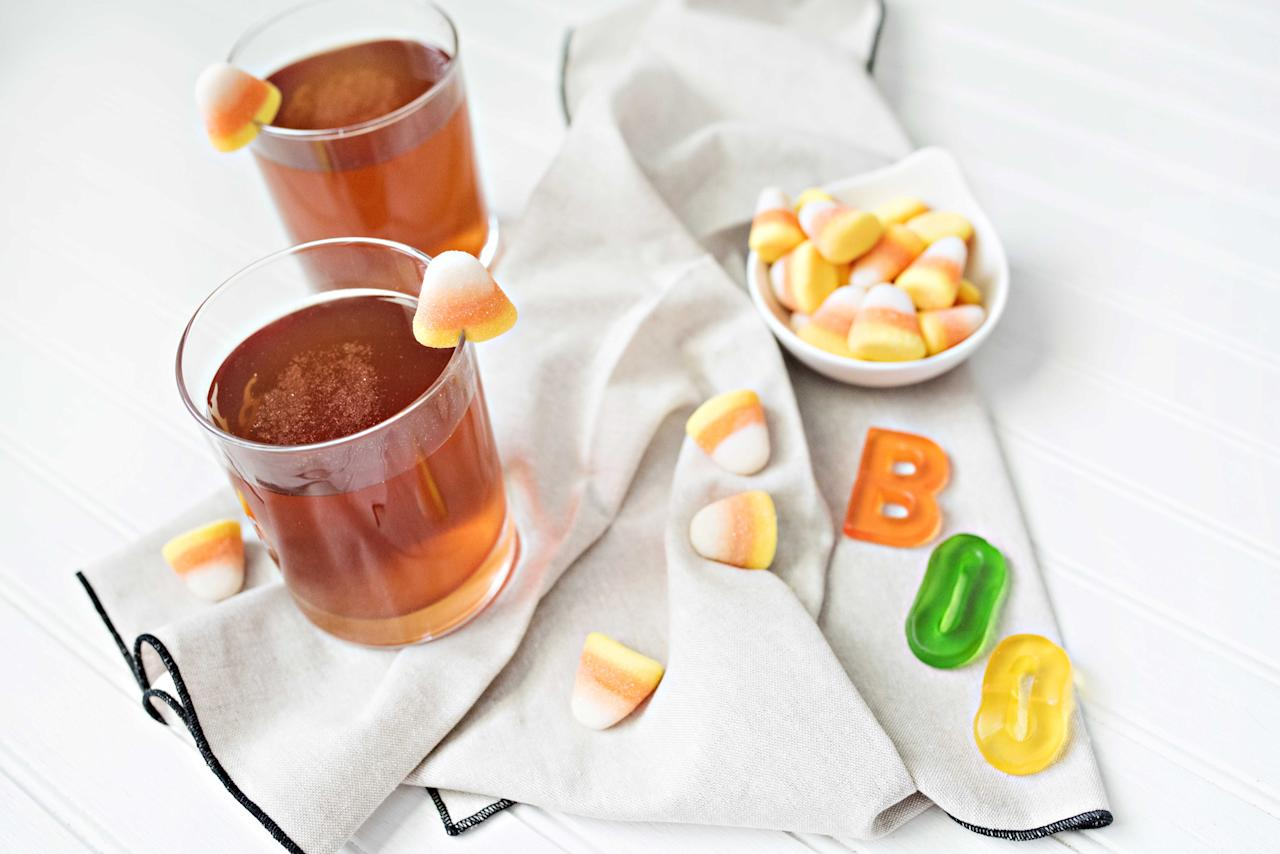 """<p>One must-have Halloween cocktail is a spiked apple cider. This is a perfect fall cocktail, not only because it revolves around apples, but also because it will warm your guests up while the aroma of apples, cinnamon and pumpkins fills your home. I recently tasted a smooth small batch rum made in the Outer Banks, NC and immediately knew that I wanted to incorporate it into an apple cider cocktail. I love the pecan and honey flavors in <a rel=""""nofollow"""" href=""""http://outerbanksdistilling.com/"""">Kill Devil Rum</a>, which makes it a necessary ingredient in the Drunken Rum Apple Cider recipe below. Let's be honest, you don't need to have a party to enjoy a glass of rummy apple cider with this perfect Halloween cocktail recipe.<b> </b> <b>Drunken Rum Apple Cider Recipe </b> <i>Ingredients</i> 1 oz Kill Devil Rum 1 oz Fonseca 10yr Tawny Port 3 Dashes of Angostura Bitters 4 oz Hot Apple Cider 1 Scoop of Pumpkin Butter (which can be found at your local grocery store) Garnish: Gummy Candy Corn <i>Directions</i> Combine the Kill Devil Rum, port, Angostura Bitters, apple cider and pumpkin butter in a glass. Stir well. Garnish with gummy candy corn. </p>"""