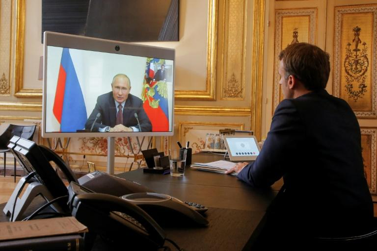 French President Emmanuel Macron talks to Russian President Vladimir Putin during a videoconference on June 26 at the Elysee Palace in Paris