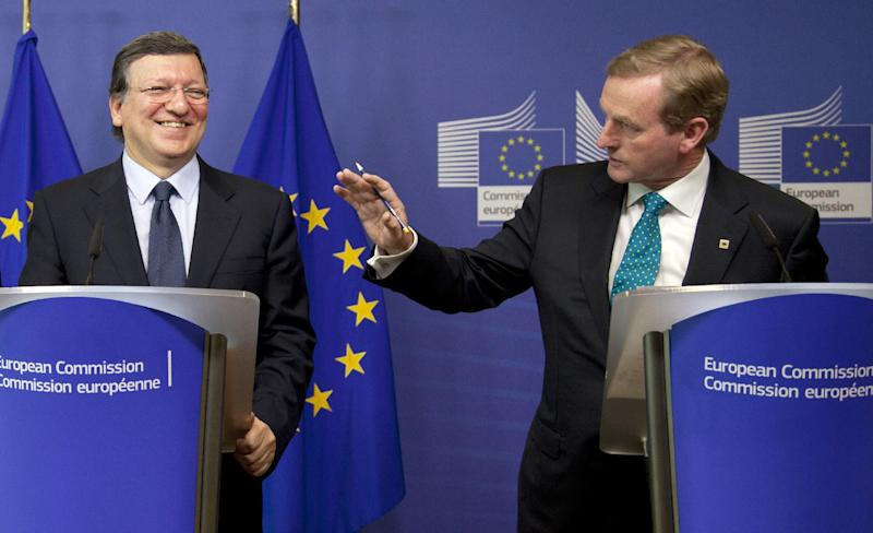 Irish Prime Minister Enda Kenny, right, and European Commission President Jose Manuel Barroso participate in a media conference at EU headquarters in Brussels on Thursday, June 27, 2013. The European Union may soon have a new seven-year budget after a surprise breakthrough deal was announced Thursday morning. European Commission President Jose Manuel Barroso announced the agreement Thursday after late-night talks with the president of the European Parliament and other officials from EU member states. Barroso said it includes more flexibility than earlier versions. (AP Photo/Virginia Mayo)