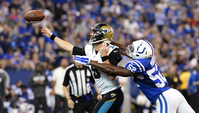 <p>Jacksonville Jaguars Blake Bortles (5) releases a pass under pressure from Indianapolis Colts linebacker Barkevious Mingo (52) at Lucas Oil Stadium. Mandatory Credit: Thomas J. Russo-USA TODAY Sports </p>