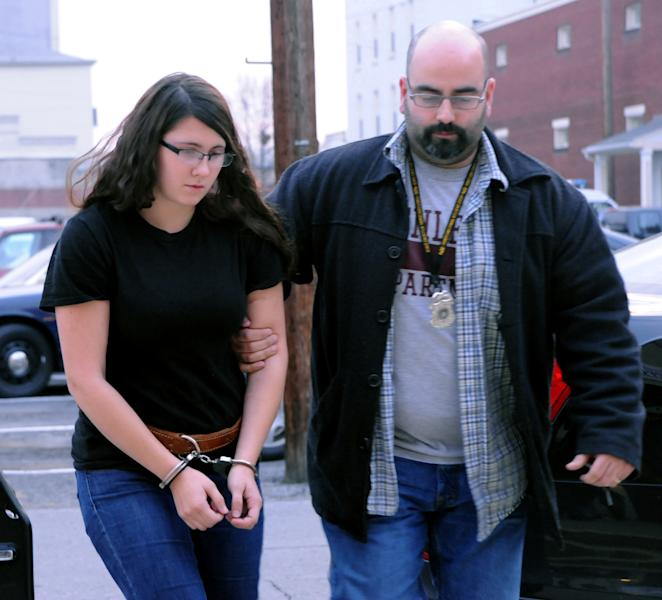 In this Tuesday, Dec. 3, 2013 photo, Miranda K. Barbour is led into District Judge Ben Apfelbaum's office in Sunbury, Pa., by Sunbury policeman Travis Bremigen. Elytte Barbour told officers before his arrest Friday, Dec. 6, that he and his wife, Miranda, had planned to kill before, but their plans never worked out until last month when Troy LaFerrara responded to an online posting that promised companionship in return for money, authorities said. Elytte Barbour, 22, and Miranda Barbour, 18, face criminal homicide charges in LaFerrara's death. His body was found Nov. 12 in an alley in Sunbury, a small city about 100 miles northwest of Philadelphia. (AP Photo/The News-Item, Mike Staugaitis) MANDATORY CREDIT