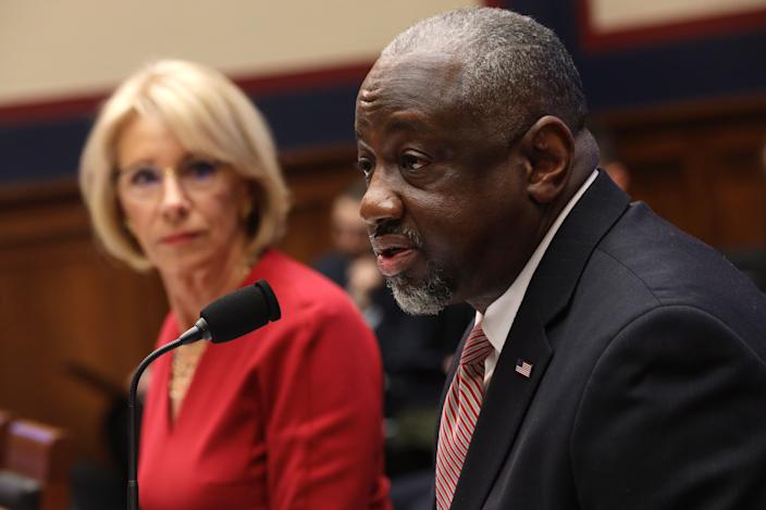 WASHINGTON, DC - DECEMBER 12:  U.S. Secretary of Education Betsy DeVos (L) listens as Chief Operating Officer of Federal Student Aid Mark Brown (R) speaks during a hearing before House Education and Labor Committee December 12, 2019 on Capitol Hill in Washington, DC. The committee held a hearing on