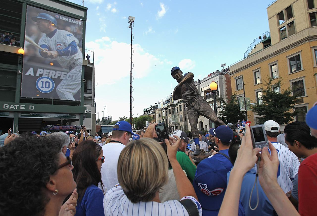 CHICAGO, IL - AUGUST 10: Fans take photos of a statue of former Chicago Cub player and broadcaster Ron Santo which was unveiled outside of Wrigley Field before a game between the Cubs and the Washington Nationals on August 10, 2011 in Chicago, Illinois. (Photo by Jonathan Daniel/Getty Images)