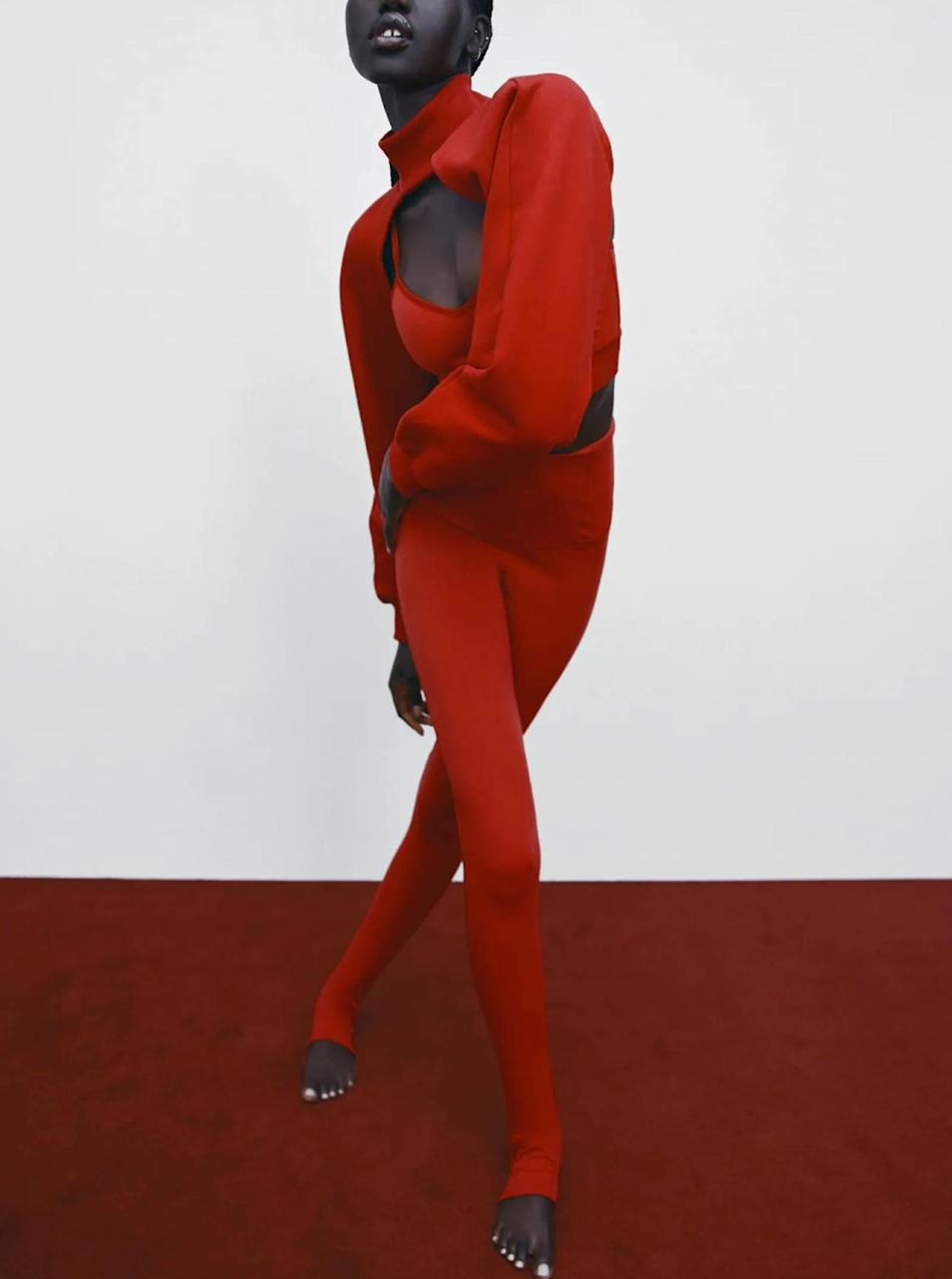 """Forget about """"keeping things subtle"""". This fiery red coverup is bound to turn <em>all</em> the heads on your next brunch date. $26, Zara. <a href=""""https://www.zara.com/us/en/mock-neck-arm-warmers-p05644304.html?"""" rel=""""nofollow noopener"""" target=""""_blank"""" data-ylk=""""slk:Get it now!"""" class=""""link rapid-noclick-resp"""">Get it now!</a>"""
