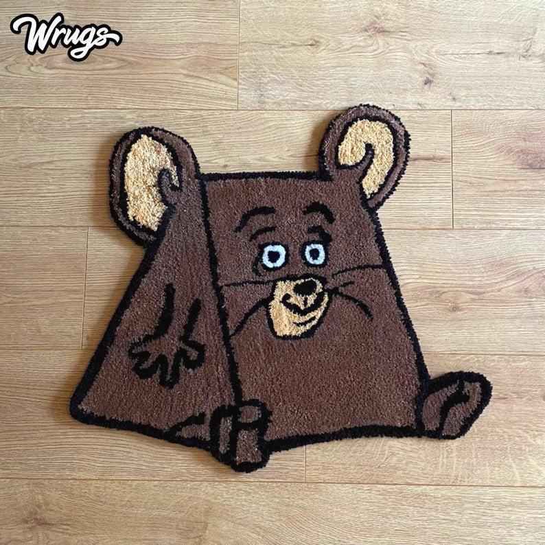 """Ultimately though, the world of tufting is nothing without cartoon characters. The time that Jerry ate too much cheese being immortalised in a rug is the epitome of why the craft is so beloved.<br><br><strong>Wrugs</strong> Jerry Hand Tufted Cartoon Rug, $, available at <a href=""""https://www.etsy.com/uk/listing/1018955960/jerry-hand-tufted-cartoon-rug-mouse-rug?"""" rel=""""nofollow noopener"""" target=""""_blank"""" data-ylk=""""slk:Etsy"""" class=""""link rapid-noclick-resp"""">Etsy</a>"""