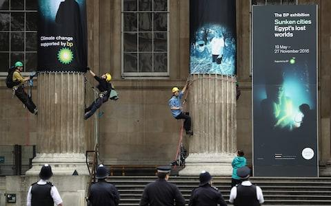 Greenpeace activists protest outside the British Museum in 2016  - Credit: Dan Kitwood/Getty Images