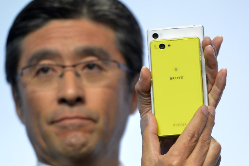 Kunimasa Suzuki, executive vice president, Sony Corporation and president and chief executive officer of Sony Mobile Communications, unveils the new Sony EXPERIA Z1 Compact during the Sony news conference at the International Consumer Electronics Show Monday, Jan. 6, 2014, in Las Vegas. The smaller phone has the same features as the ZPERIA Z1(AP Photo/Jack Dempsey)