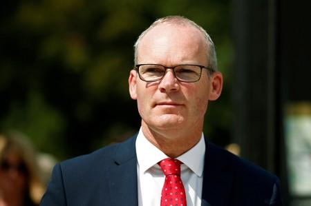 FILE PHOTO: Irish Foreign Minister Simon Coveney attends a conference in Paris