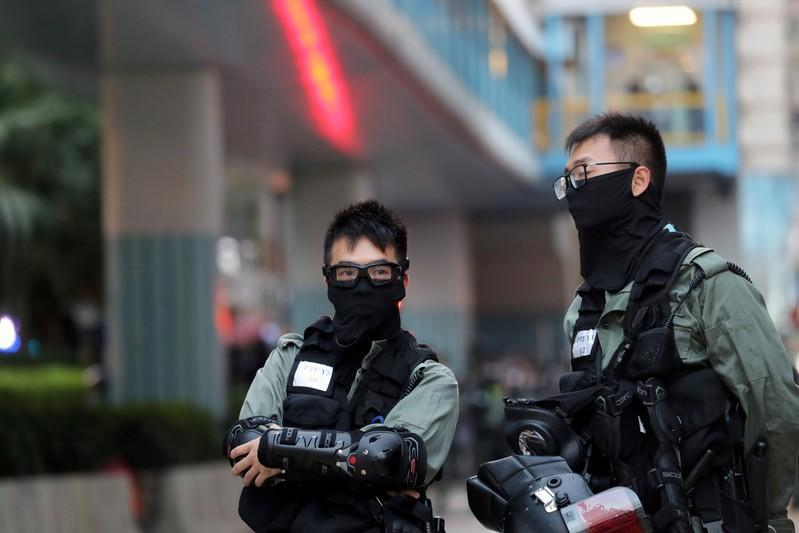Police officers stand inside the campus of the Polytechnic University (PolyU) in Hong Kong