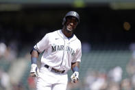 Seattle Mariners' Taylor Trammell smiles as he rounds the bases after hitting a solo home run during the sixth inning a baseball game, Wednesday, June 23, 2021, in Seattle. The hit ended Marquez's no hitter to that point. (AP Photo/John Froschauer)