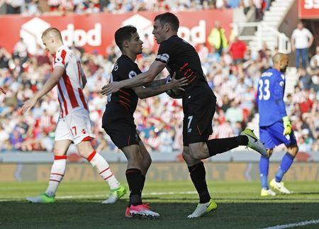Britain Football Soccer - Stoke City v Liverpool - Premier League - bet365 Stadium - 8/4/17 Liverpool's Philippe Coutinho celebrates scoring their first goal with James Milner Reuters / Darren Staples Livepic