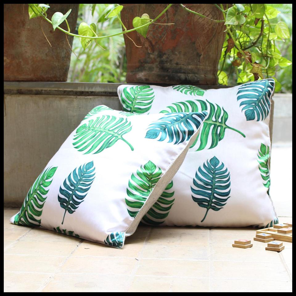 "The<a href=""https://www.cyahi.com/products/monstera-cushion-cover""> </a><a href=""https://fave.co/32aX5cG"">Monstera Cushion Cover</a> from Cyahi is crafted from dupion silk. <em>Rs. 899 each</em>."