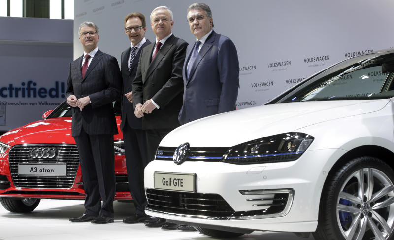 From left: Audi CEO Rupert Stadler, VW member of the board Michael Macht, Volkswagen CEO Martin Winterkorn and VW member of the board Francisco Javier Garcia Sanz, pose for the media prior to the company's annual press conference in Berlin, Germany, Thursday, March 13, 2014. German automaker Volkswagen is raising its dividend after turbocharged earnings from its Porsche luxury line outweighed slipping revenues from mass-market cars. (AP Photo/Michael Sohn)