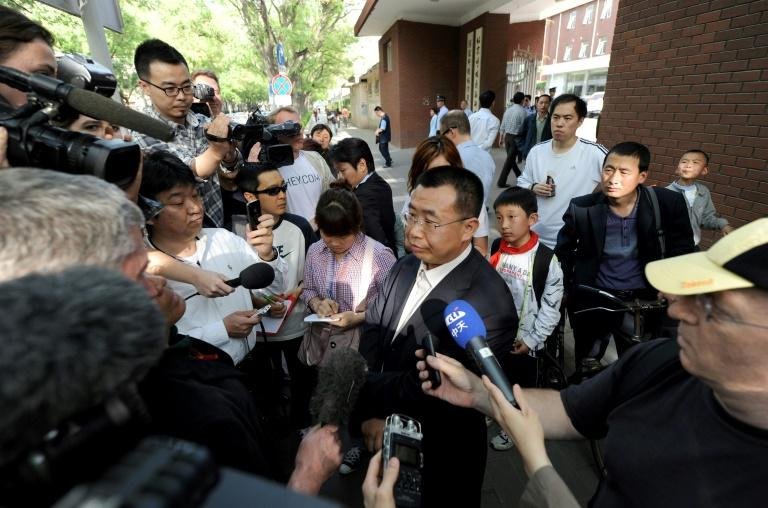 Chinese rights lawyer Jiang Tianyong (C) speaking to foreign media in May 2012 outside the Chaoyang hospital in Beijing, where blind activist Chen Guangcheng was believed to be getting a check up
