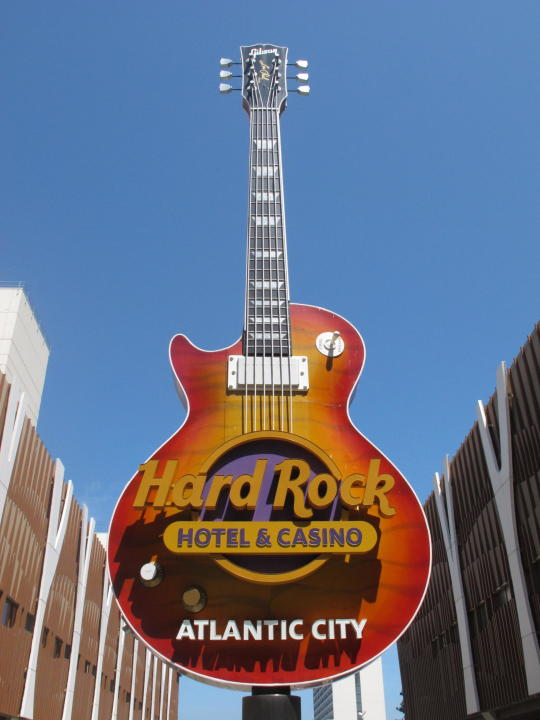 This Monday, June 28, 2021 photo shows the giant guitar in the front of the hard Rock casino in Atlantic City N.J. Hard Rock last year finished second only to the Borgata in terms of money won from in-person gamblers. (AP Photo/Wayne Parry)