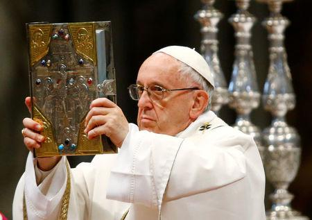 FILE PHOTO: Pope Francis blesses oils on Holy Thursday during Chrism mass