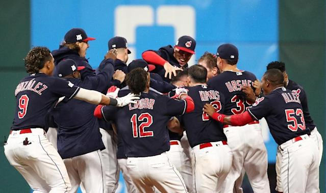The Cleveland Indians celebrate defeating The New York Yankees 9 to 8 in the 13th inning during game two of the American League Division Series in Cleveland, Ohio (AFP Photo/Gregory Shamus)