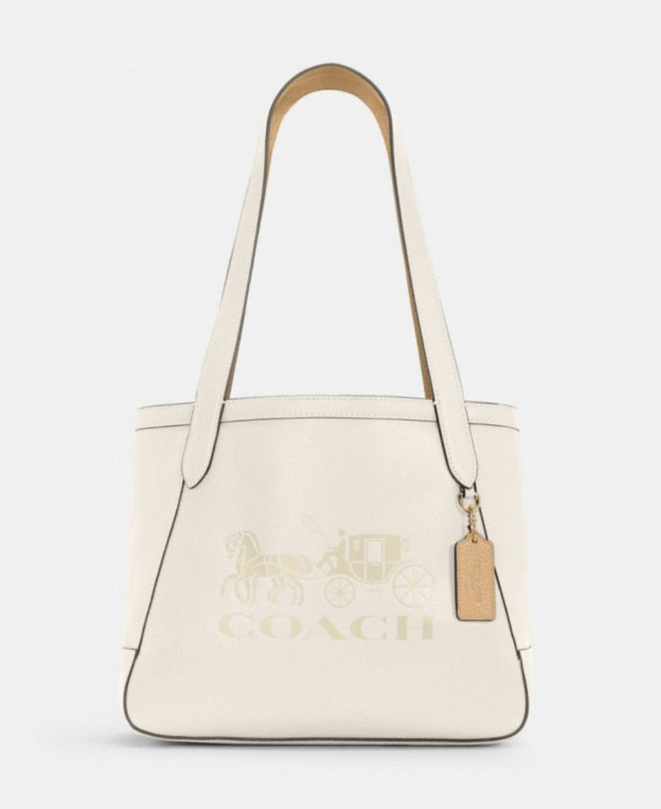 Horse And Carriage Tote in Vanilla Cream (Photo via Coach Outlet)