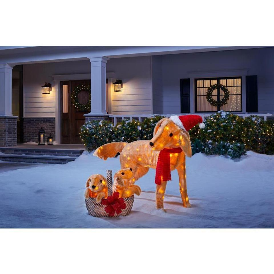 """<p><strong>Home Accents Holiday</strong></p><p>homedepot.com</p><p><strong>$79.98</strong></p><p><a href=""""https://go.redirectingat.com?id=74968X1596630&url=https%3A%2F%2Fwww.homedepot.com%2Fp%2FHome-Accents-Holiday-2-Piece-Adorable-Dogs-LED-Golden-Retriever-with-Basket-of-Puppies-TY394-2014-2%2F312926968&sref=https%3A%2F%2Fwww.womansday.com%2Fhome%2Fdecorating%2Fg34291455%2Foutdoor-christmas-decorations%2F"""" rel=""""nofollow noopener"""" target=""""_blank"""" data-ylk=""""slk:Shop Now"""" class=""""link rapid-noclick-resp"""">Shop Now</a></p><p>Puppies are always a win-win! This yard sculpture is a less common, but still gorgeous, way to show your holiday spirit. The golden retriever mom and her puppies feature countless LED lights on a durable metal frame with weather-resistant fabric. It's easy to set up and includes the stakes you'd need to make it stand. <br></p>"""