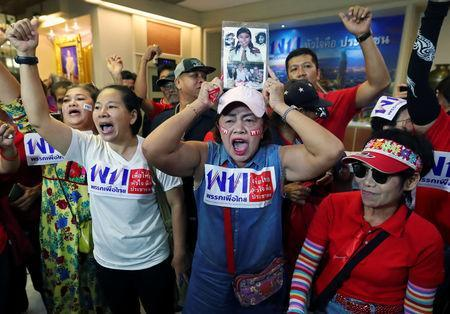 Supporters of Pheu Thai Party react after unofficial results, during the general election in Bangkok, Thailand, March 24, 2019. REUTERS/Athit Perawongmetha