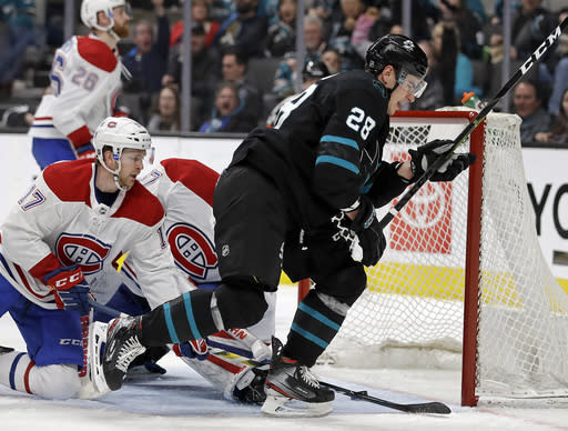 San Jose Sharks' Timo Meier, right, celebrates after scoring a goal past Montreal Canadiens' Brett Kulak (17) during the third period of an NHL hockey game Thursday, March 7, 2019, in San Jose, Calif. (AP Photo/Ben Margot)