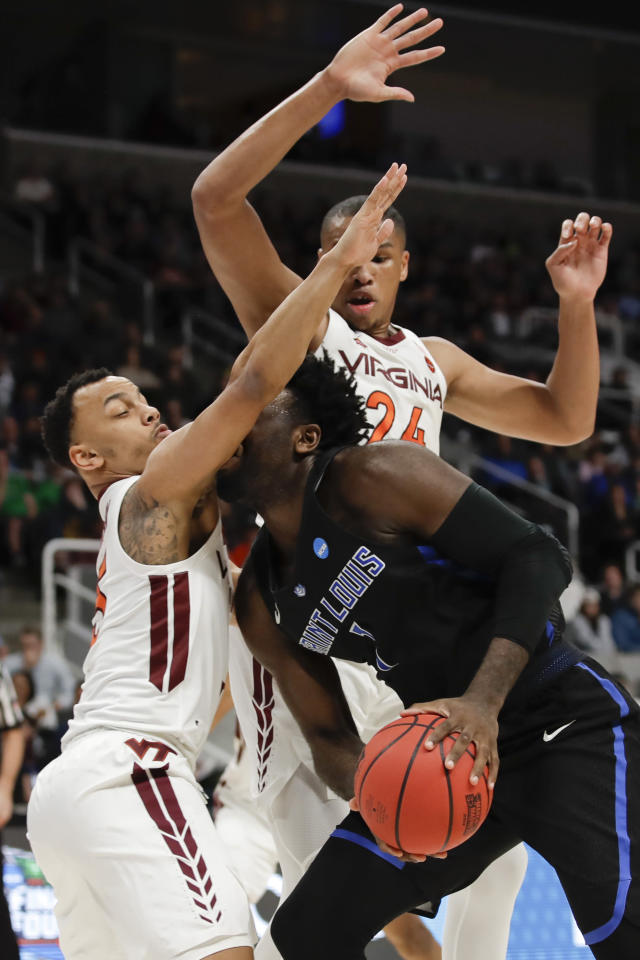 Virginia Tech guard Justin Robinson, let, blocks Saint Louis forward D.J. Foreman's route to the basket during the first half of a first-round game in the NCAA men's college basketball tournament Friday, March 22, 2019, in San Jose, Calif. (AP Photo/Ben Margot)