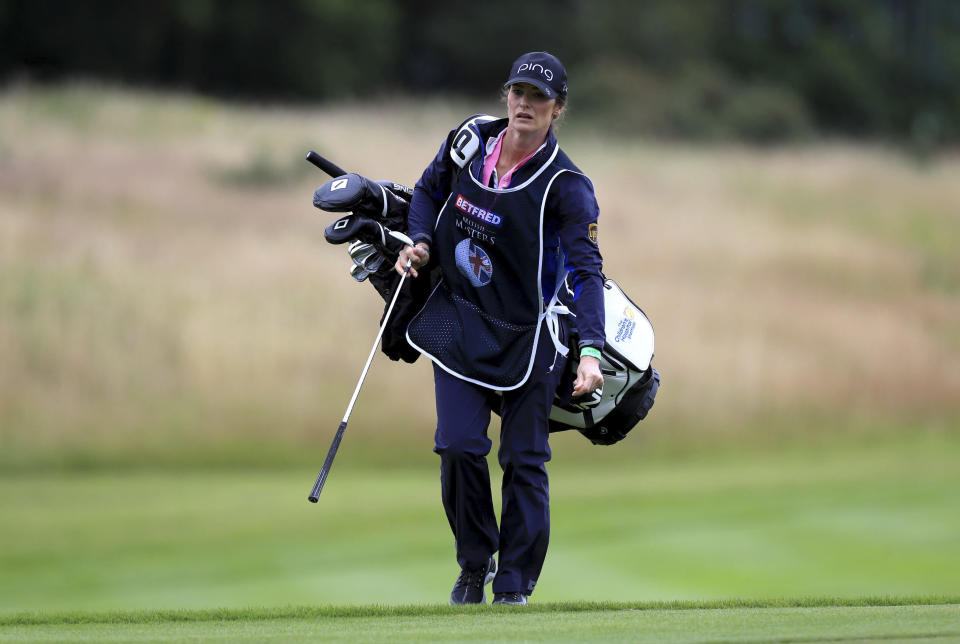 Lee Westwood's girlfriend and caddie, Helen Storey during day one of the British Masters at Close House Golf Club, near Newcastle, England, Wednesday July 22, 2020. The European Tour resumes in earnest after its pandemic-induced shutdown with the British Masters starting Wednesday. (Mike Egerton/PA via AP)